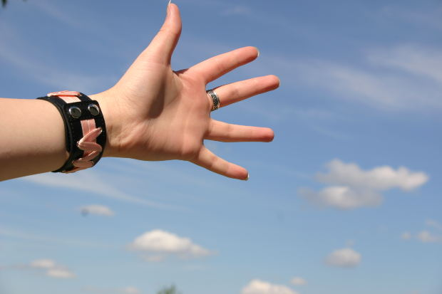 hand with sky in background
