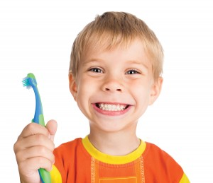 child smiling with toothbrush