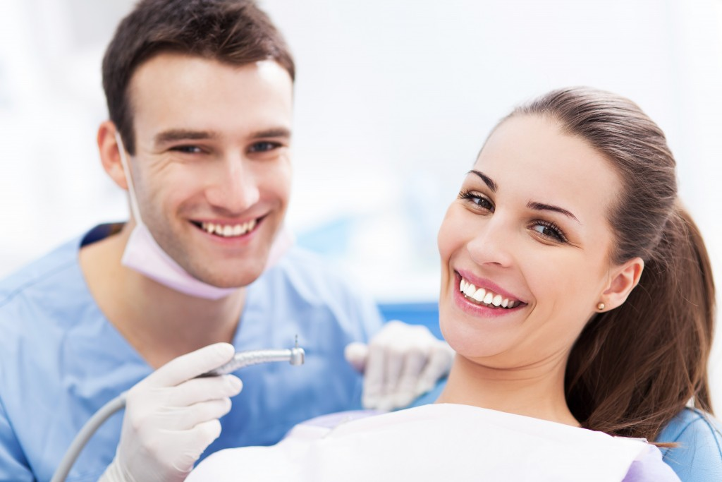 Male dentist and woman patient