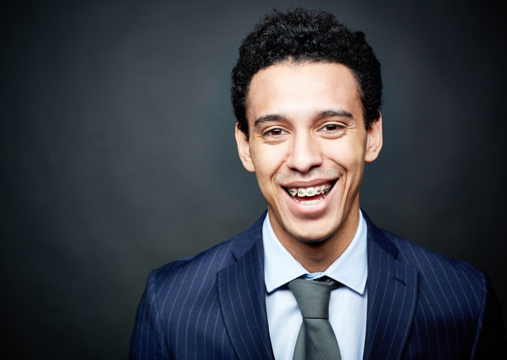 Man in a suit with braces