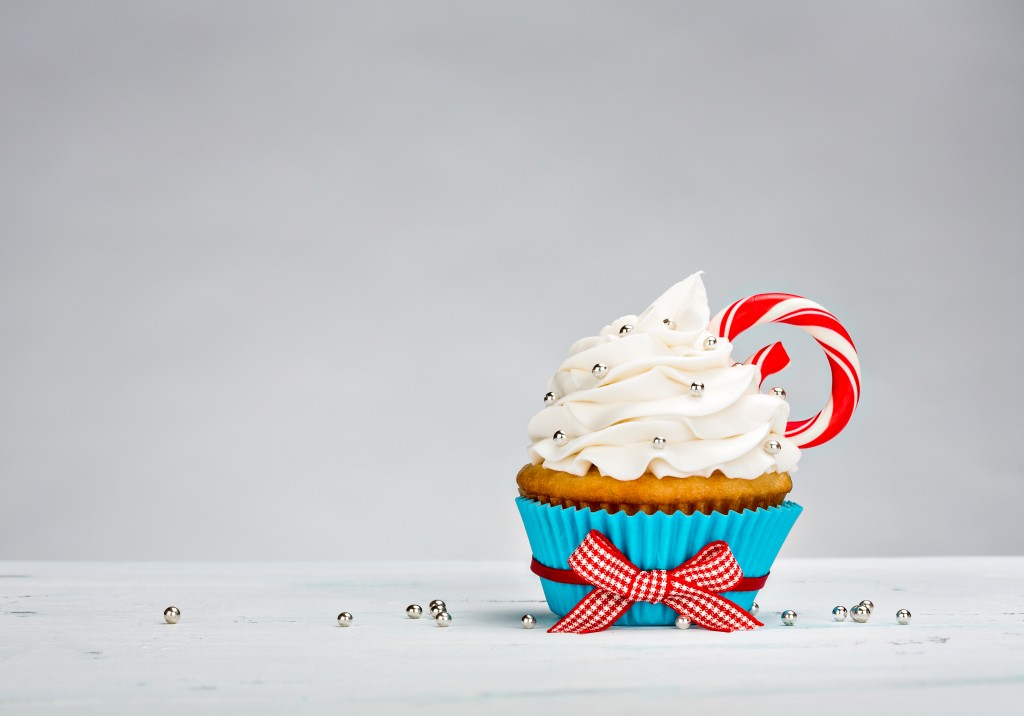 Cupcake with a peppermint stick.