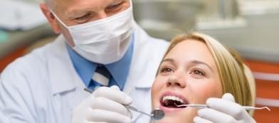 Dentist working on female patient