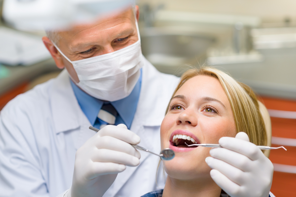 Dentist working on female patient