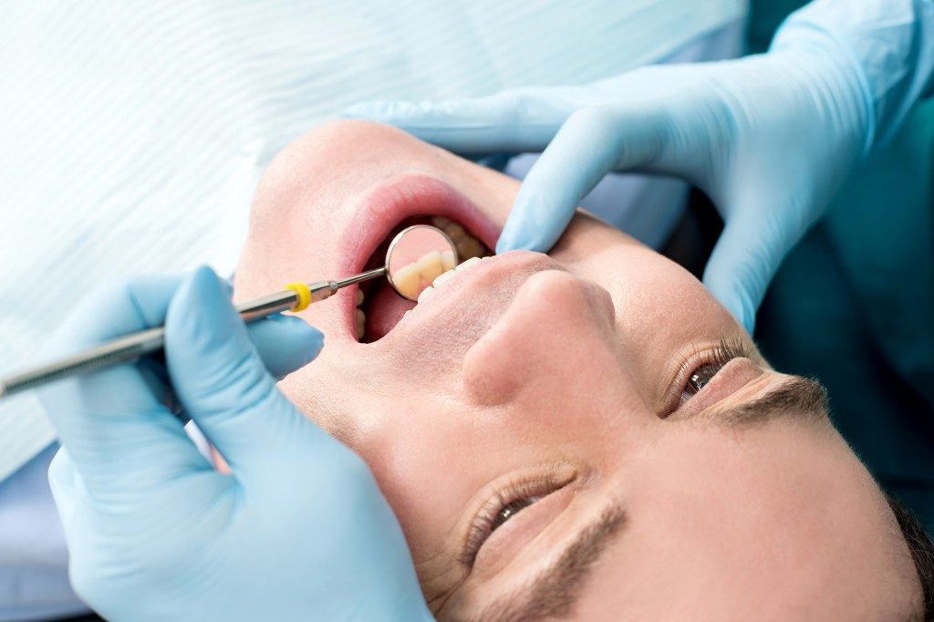 Man receiving dental care