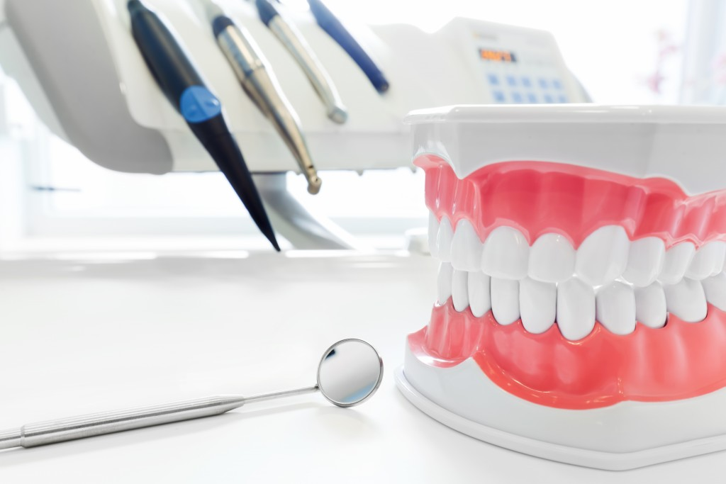 dentures next to dental equipment