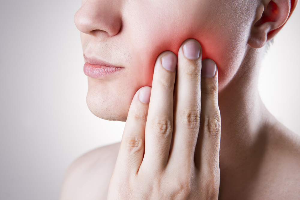 woman with a sore tooth because of an infection