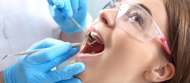 Woman having a cavity worked on by a dentist in Las Vegas