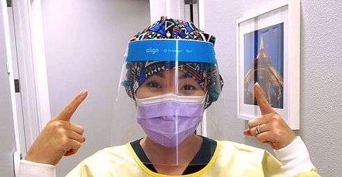 staff members wear face shields during exams and treatment